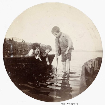 Boy paddling in the sea (<em>circa</em> 1890)