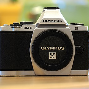 FOR SALE: Olympus OM-D E-M5, silver, body only, still under warranty