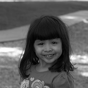 B&W picture of my daughter with the Panasonic 42.5mm F.12 Nocticron lens