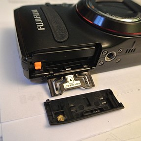 How to fix the battery/SD card door on a Finepix 550?