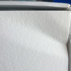 Ironing the paper to cure folded corner?