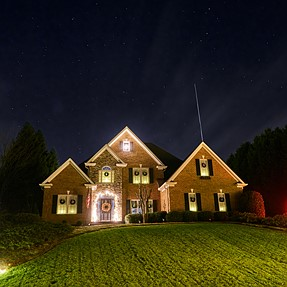 Got lucky taking a picture of our house and caught a meteor