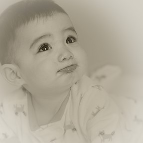 High key natural light portrait of baby