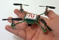 Flying helicopter camera captures video while streaming to smartphones